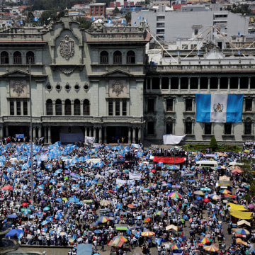 Image: Anti-government protesters participate in a march in Guatemala City