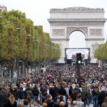 "Image: People walk down the Champs Elysees avenue during a ""car free"" day"