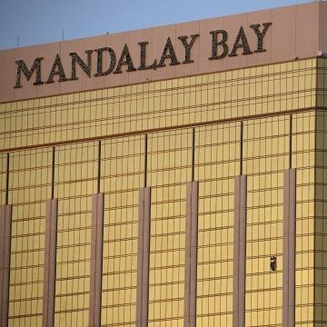 Image: Drapes billow out of broken windows at the Mandalay Bay Resort and Casino