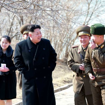 Image: North Korean leader Kim Jong-un touring a military unit on an island off the North Korean mainland near the sea border with South Korea in the East Sea. Kim's younger sister, Yo-jong, is seen behind.