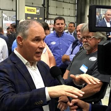 Image: EPA Administrator Scott Pruitt talks to a reporter
