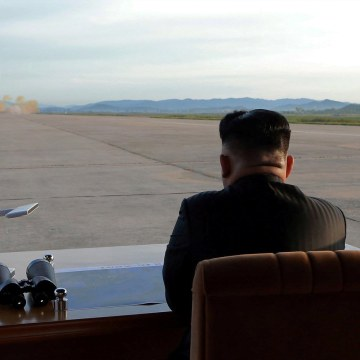 Image: North Korean leader Kim Jong Un watches the launch of a Hwasong-12 missile
