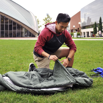 Image: Vick Liu unrolls his TravlerPack, a lightweight sleeping bag, outside the Kresge Auditorium at the Massachusetts Institute of Technology in Cambridge, Massachusetts, Oct. 6, 2017.