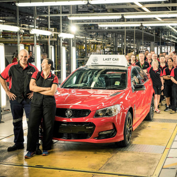 Image: Holden Auto workers with the last car to roll off their production line