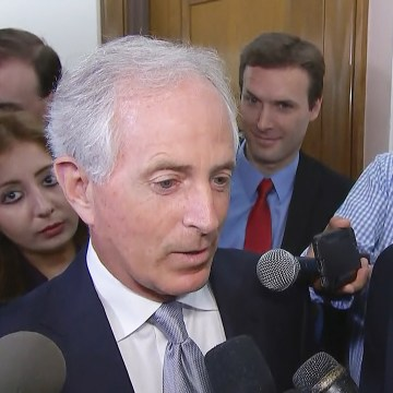 Image: Ryan Clayton of Americans Take Action stands behind Senator Bob Corker during his stakeout on Capitol Hill on Oct. 24, 2017.
