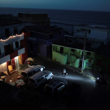 Image: A house is lit up with the help of a generator next to houses in the dark, after Hurricane Maria hit the island and damaged the power grid in September, in Old San Juan