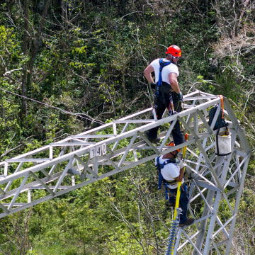 Image: Whitefish Energy Holdings workers restore power lines damaged by Hurricane Maria in Barceloneta, Puerto Rico
