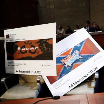 Image: Examples of Facebook pages are seen, as executives appear before the House Intelligence Committee to answer questions related to Russian use of social media to influence U.S. elections, on Capitol Hill in Washington