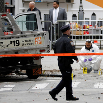 Image: Law Enforcement officials investigate a pickup truck used in an attack on the West Side Highway in lower Manhattan in New York