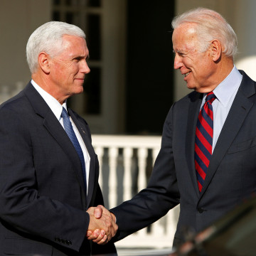Image: Vice President Joe Biden shakes hands with Vice President-elect Mike Pence after their meeting and lunch at the Naval Observatory in Washington