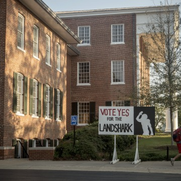 Image: A sign encouraging Ole Miss students to support a mascot change