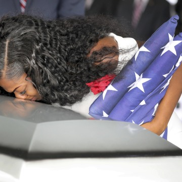 Image: Myeshia Johnson, wife of U.S. Army Sergeant La David Johnson, kisses his coffin at a graveside service