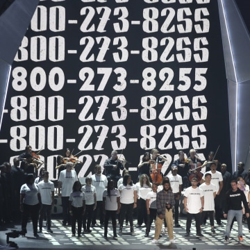 """Image: Khalid, from left, Logic, and Alessia Cara perform """"1-800-273-8255"""" at the MTV Video Music Awards"""