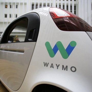 Image: The Waymo driverless car is displayed during a Google event
