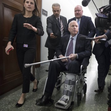 Image: Members of the media follow Senator John McCain following an Armed Services Committee hearing on Capitol Hill