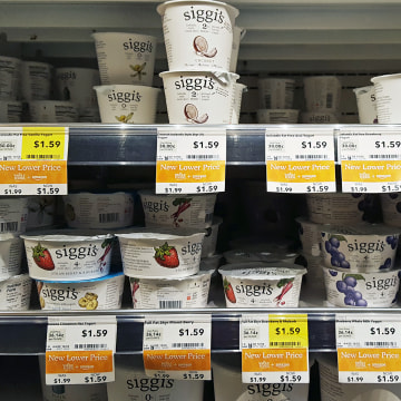 Image: Siggi's yogurts are seen with lower, Amazon prices on the shelves of Whole Foods.