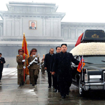 Image: Kim Jong-Un and senior members of the North Korean regime walk beside the body of his father Kim Jong-Il in 2011.
