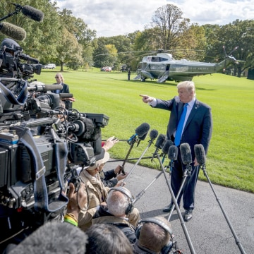Image: President Donald Trump calls on a reporter before boarding Marine One on the South Lawn of the White House in Washington, on Oct. 25, 2017, for a short trip to Andrews Air Force Base, Maryland and then on to Dallas.