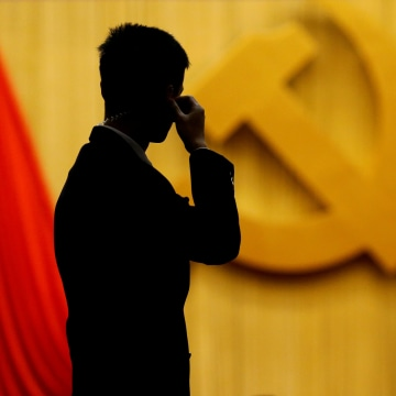Image: FILE PHOTO: A security agent takes position at the Great Hall of the People during the opening session of the 19th National Congress of the Communist Party of China in Beijing
