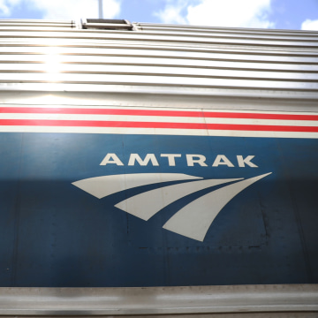 Image: An Amtrak train waits at a station