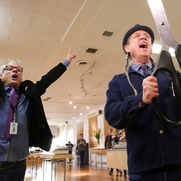 Image: Andrew and Steve DeAngelo celebrate after a ceremonial ribbon cutting on the first day of legalized recreational marijuana in Oakland