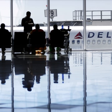 Image: A Delta Air Lines jet sits at a gate at Hartsfield-Jackson Atlanta International Airport, in Atlanta on Oct. 13, 2016.