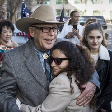 Image: Cliven Bundy hugs Maysoun Fletcher, an attorney for his son Ryan