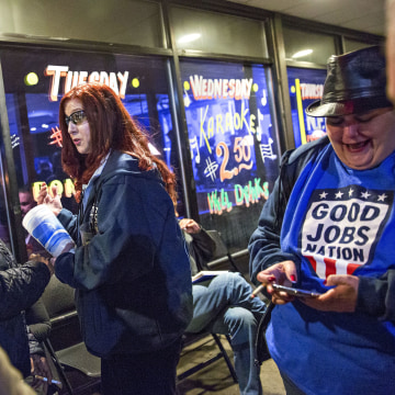 "Image: Renee Elliott, a press operator at Carrier Corp., chats with colleagues after participating in a ""The State of the Working Class"" event, sponsored by Good Jobs Nation, in Indianapolis, Indiana, on Wednesday, Jan. 10, 2018."