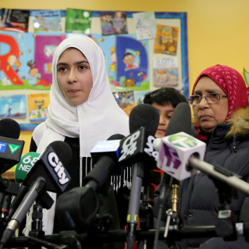 Image: Khawlah Noman, 11, speaks to reporters with her mother at Pauline Johnson Junior Public School, after she told police that a man cut her hijab with scissors in Toronto, Ontario, Canada on Jan. 12, 2018.
