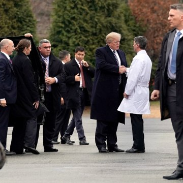 Image: U.S. President Donald Trump shakes hands with Dr. Ronny Jackson after his annual physical exam at Walter Reed National Military Medical Center in Bethesda