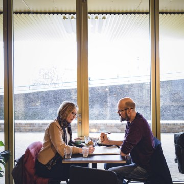 Image: Mette Brathen, teacher, and her partner Henning Velo, an engineer, both 45, have a late breakfast in a caf? in the working class T?yen neighborhood.
