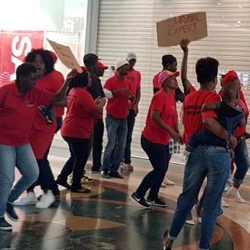 Image: People protest in front of H&M store in Cape Town