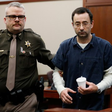 Image: Former team USA Gymnastics doctor Larry Nassar is escorted by a court officer during his sentencing hearing in Lansing