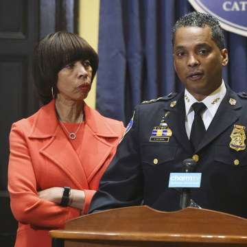 Image: Mayor Catherine Pugh listens to new Baltimore police commissioner Darryl DeSousa