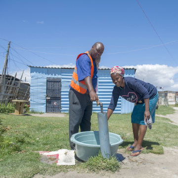 Image: People collect water from a communal tap at an informal settlement near Cape Town, South Africa, Tuesday, Jan. 23, 2018, as a harsh drought may force South Africa's showcase city of Cape Town to turn off most of its taps.
