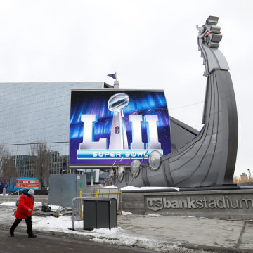 Image: A man walks by US Bank Stadium, home to this weekend's Super Bowl, in downtown Minneapolis, Minnesota