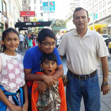 Image: Syed Ahmed Jamal, seen with his three kids, was arrested the lawn of his Kansas home on Jan. 24.