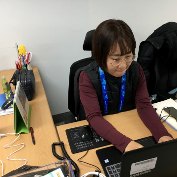 Image: Jeon Won Hee, a counselor with Gender Equality Support Center, works in the Olympic Park to respond to sexual assault victims.