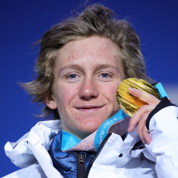 Image: Gold medalist Red Gerard of the United States poses on the podium during the medal ceremony