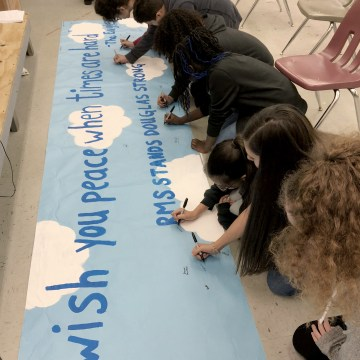 Image: Students at Ramblewood Middle School in Broward County, Florida, paint a banner during drama class for students at Stoneman Douglas High School, on Feb. 16, 2018.