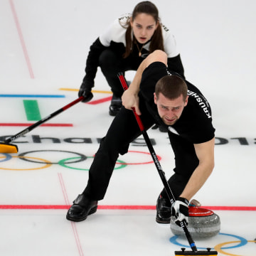 Image: Anastasia Bryzgalova and Alexander Krushelnitskiy of Olympic Athletes of Russia in action in the mixed doubles bronze medal match between Norway and Olympic Athletes of Russia at the Gangneung Curling Center on Feb. 13, 2018.
