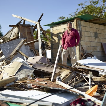 Image: The roof of Roberto's home was destroyed by Hurricane Irma in Isabela, Puerto Rico