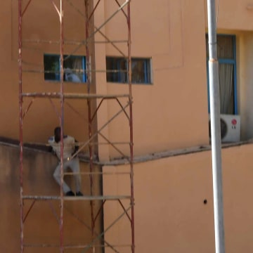Image: Men escape from Burkina Faso's army headquarters during an attack in Ougadougou, Burkina Faso