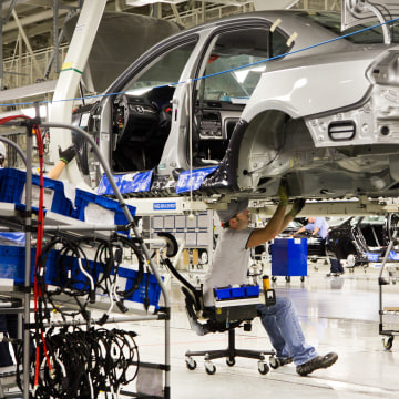 Image: An employee works on a Passat sedan at the Volkswagen plant in Chattanooga, Tennessee on July 31, 2012.