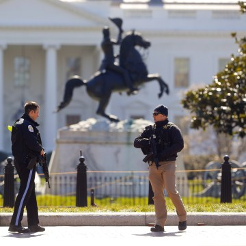 Image: Law enforcement officers at Lafayette Park across from the White House in Washington, close the area to pedestrian traffic, on March 3, 2018.