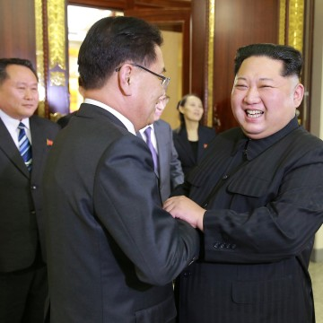 Image: North Korean leader Kim Jong Un greets a member of the special delegation of South Korea's President at a dinner in this photo released by North Korea's Korean Central News Agency