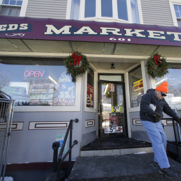 Image: A customer departs Reeds Ferry Market convenience store