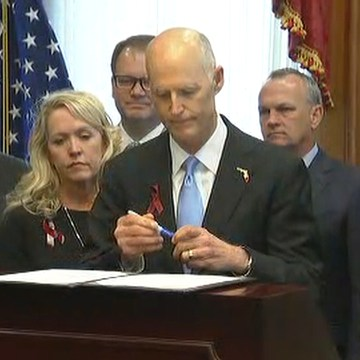 Image: Florida Gov. Rick Scott signs the Marjory Stoneman Douglas High School Public Safety Act