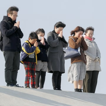 Image: People pray for the victims killed by a tsunami at 2:46 pm local time, that came after a 9.0-magnitude earthquake shook northern Japan and triggered a subsequent tsunami, seven years ago, at Arahama district, Miyagi Prefecture, on March 11, 2018.