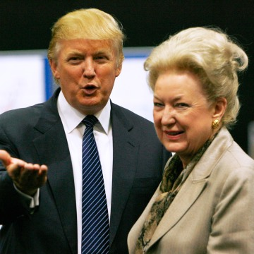 Donald Trump gestures as he stands next to his sister Maryanne Trump Barry, during a break in proceedings of the Aberdeenshire Council inquiry into his plans for a golf resort, Aberdeen